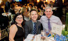 Happy attendees sitting at a table Children's Gala San Diego 2017