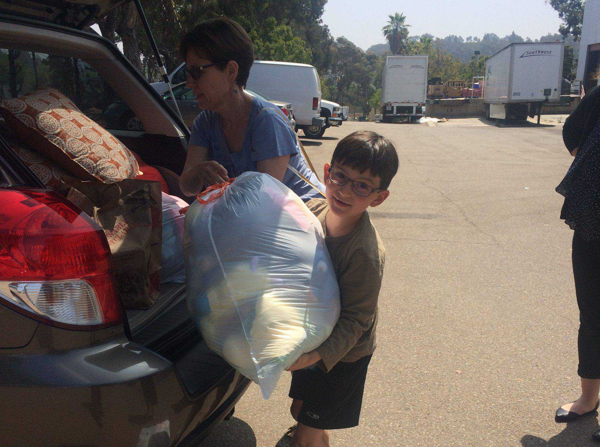 A young donor, Eli, donated over 5,000 shoes after holding a donation drive for Father Joes Villages.