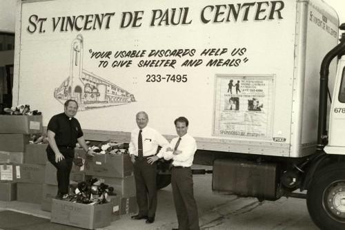 father joe in front of an old donation truck
