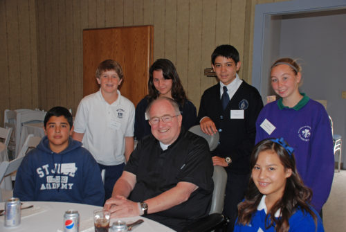 Father Joe Carroll meeting with youth.