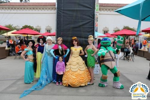 Runners posing with Ninja Turtles and Disney Princess