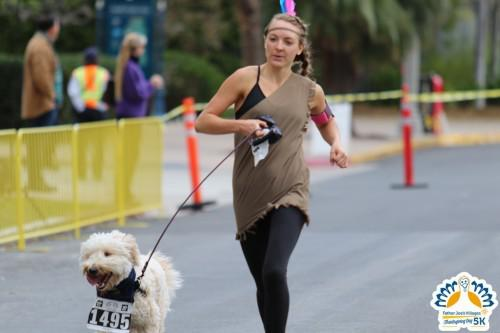 Runner with her dog is dressed as Native American at Thanksgiving 5k San Diego