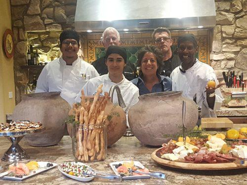 culinary arts students with platters of food
