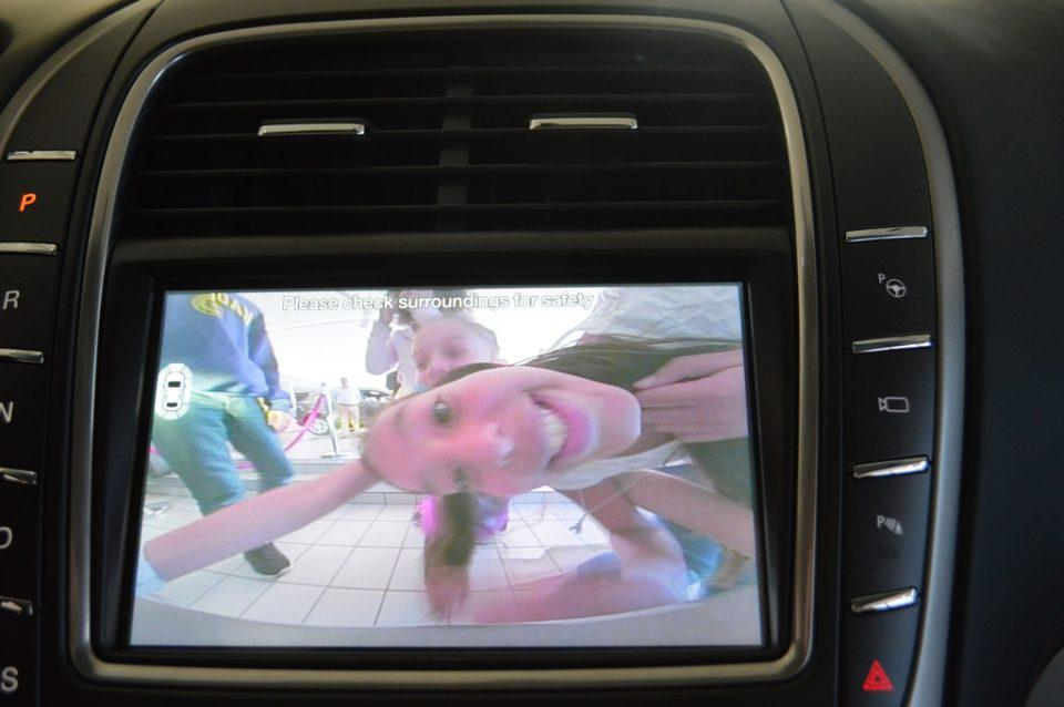 a child in a rear view car camera