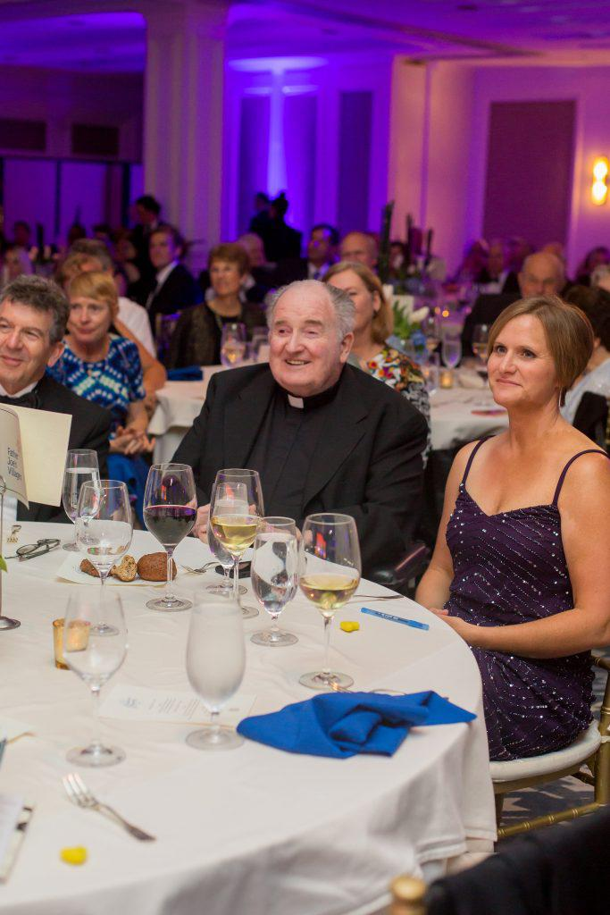 Father Joe Carroll received a standing ovation at the gala.