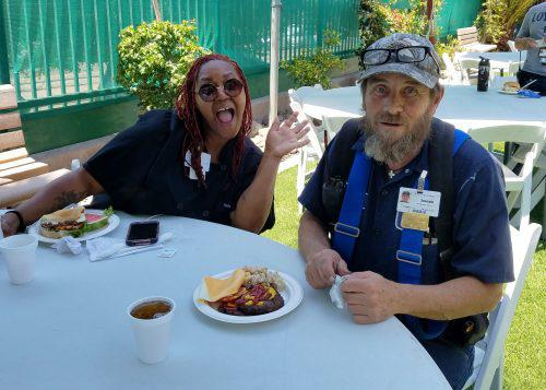 Staff members enjoy the employee appreciation barbecue.
