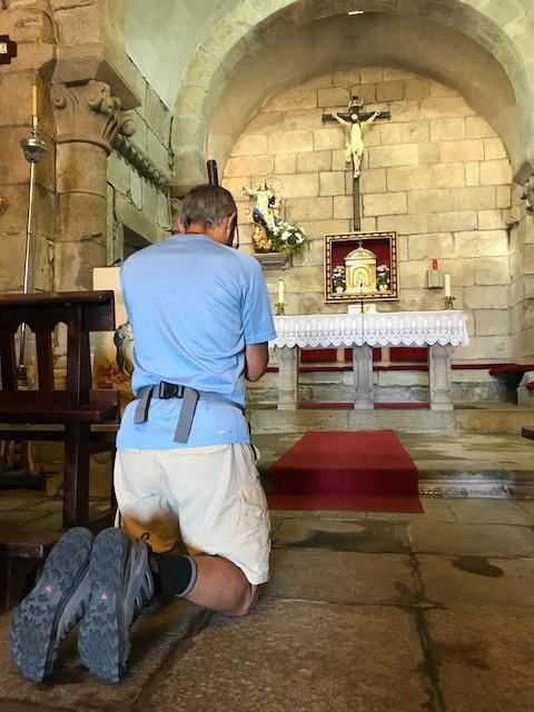 Deacon Jim Vargas prays at alter of St. Mary Magdalene