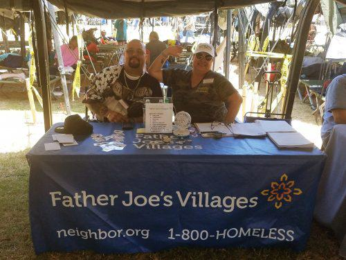 Father Joe's Villages Volunteers at a Table