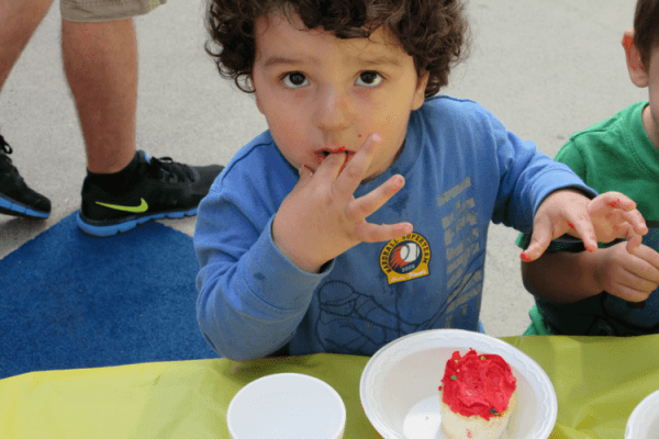 David eating a cupcake | How Therapeutic Childcare Helps Homeless Children