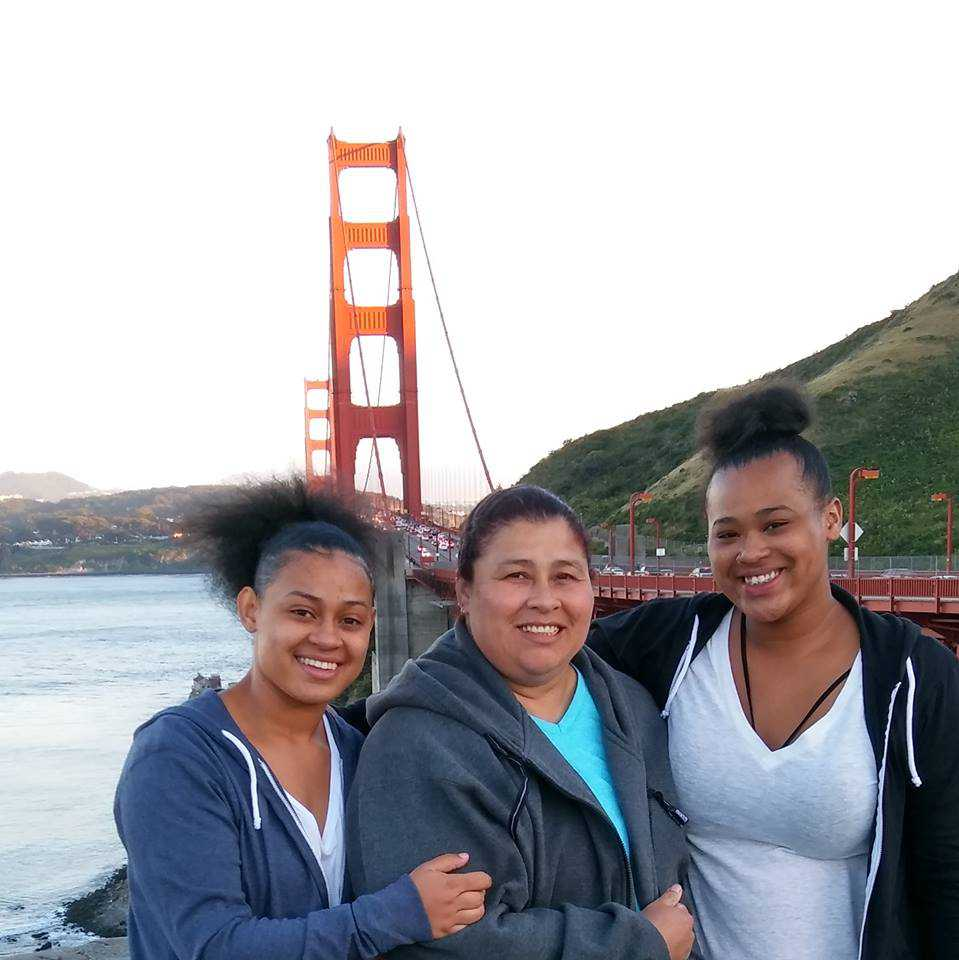 Michelle with her daughters by Golden Gate Bridge