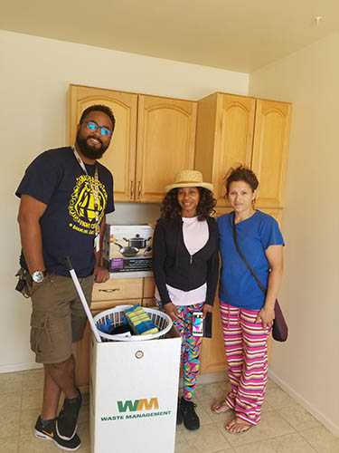 Formerly Homeless Neighbors in their New Homes with the welcome home kit | San Diego Downtown Breakfast Rotary Club