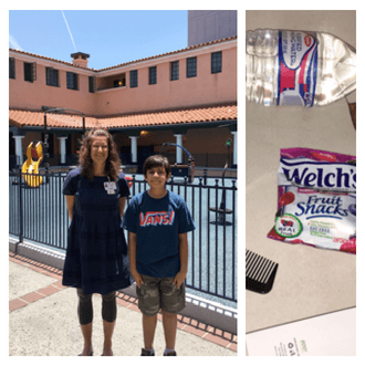 Kids Volunteer San Diego | Ishan stands next to Julie Dede, Communications Director in a courtyard during their tour of Father Joe's Villages. Next to that is Ishan's collection of items, including a water bottle, Welch's fruit snacks, a comb and a toothbrush.