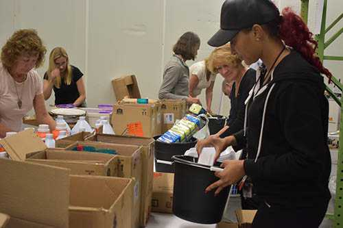 San Diego Downtown Breakfast Rotary Club Members filling Welcome Home Kits