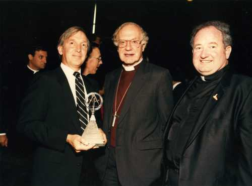 Father Joe accepting an award