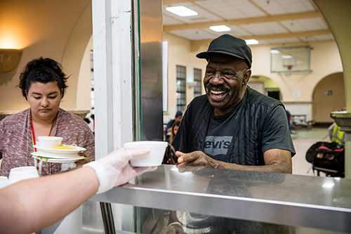 Volunteer Serving Food for Homeless San Diegans
