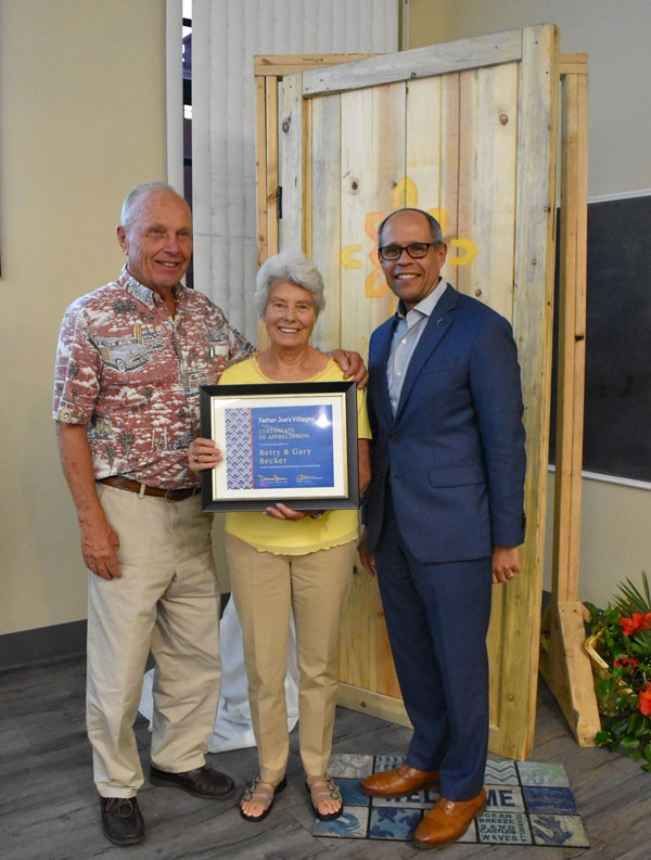 Gary & Betty Becker post with their certificate of appreciation with Deacon Jim Vargas. | Landlord Incentives Program