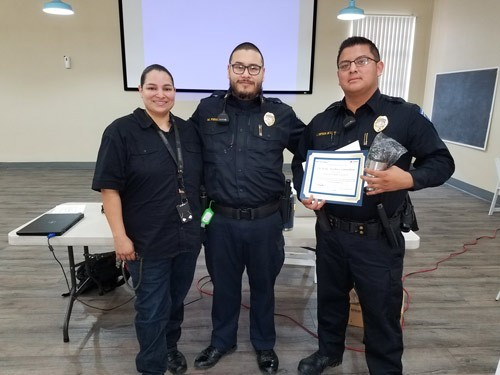 Ortega poses with his supervisors during a ceremony honoring his life-saving work. | Security at Father Joe's Villages