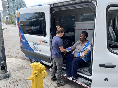 Street Health Program nurse provides outreach health services to a woman on the streets.